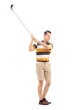 Full length portrait of a joyful man playing golf Royalty Free Stock Images