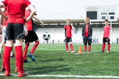 Children Practicing Football stock images