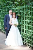 Full length portrait of just merried couple, vertical Royalty Free Stock Photo