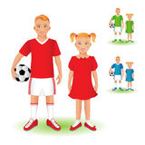 Full length portrait of a kid in sportswear holding a soccer bal Stock Photos