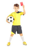 Full length portrait of a kid in sportswear holding soccer ball Royalty Free Stock Image