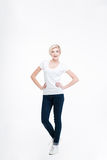 Full length portrait of a laughing blonde woman Royalty Free Stock Photos