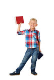 Full length portrait of laughing young boy with books isolated on white background. Education Royalty Free Stock Photo