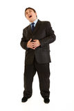 Full length portrait of laughing young businessman Stock Photography