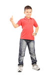 Full length portrait of little boy giving a thumb up Royalty Free Stock Photography