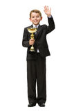 Full length portrait of little businessman with gold cup Royalty Free Stock Photography