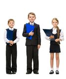 Full-length portrait of little children with folders Royalty Free Stock Images