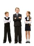 Full length portrait of little children with hands crossed Stock Image