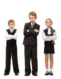 Full-length portrait of little children with hands crossed Stock Images