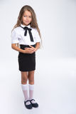 Full length portrait of a little school girl Royalty Free Stock Photo