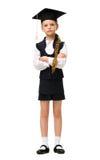 Full length portrait of little student in academic cap Stock Images