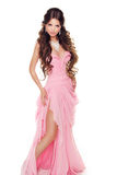 Full-length portrait of a lovely woman in romantic pink dress is Stock Image