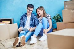Adorable Couple in New Apartment stock photo