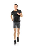Full length portrait of a male athlete running. Isolated on white background Stock Photo