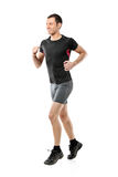 Full length portrait of a male athlete running. Isolated against white background Royalty Free Stock Photo