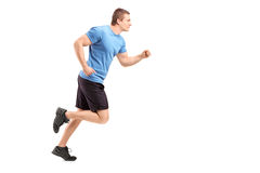 Full length portrait of a male athlete running. Isolated on white background Royalty Free Stock Photography
