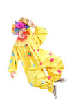 Full length portrait of a male clown jumping and gesturing. Isolated on white background Stock Photography