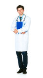 Full length portrait of a male doctor holding a notepad on white Royalty Free Stock Photos