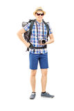Full length portrait of a male hiker with backpack and camera po Stock Image