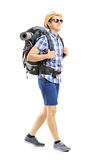 Full length portrait of a male hiker with backpack walking Royalty Free Stock Photo