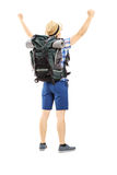 Full length portrait of a male hiker with raised hands gesturing Royalty Free Stock Image