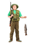 Full length portrait of a male hunter with rifle holding a fish Stock Photo
