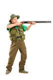 Full length portrait of a male hunter shooting with a rifle Stock Photography