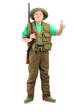 Full length portrait of a male hunter with shotgun giving a thum Royalty Free Stock Photo