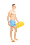 Full length portrait of a male lifeguard on duty posing Stock Image