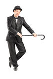 Full length portrait of a male magician holding a cane Royalty Free Stock Photography