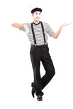 Full length portrait of a male mime artist gesturing with hand Royalty Free Stock Photo
