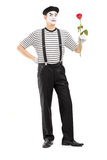 Full length portrait of a male mime artist holding a rose flower Royalty Free Stock Photography