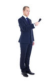 Full length portrait of male reporter with microphone isolated o. N white background Royalty Free Stock Photography
