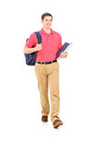 Full length portrait of a male student walking. On white background stock photo