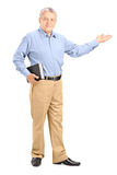 Full length portrait of a male teacher holding a book Stock Photography
