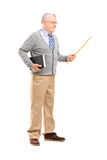 Full length portrait of a male teacher holding a wand and a book Royalty Free Stock Photography