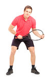 Full length portrait of a male tennis player holding a racket Stock Photography