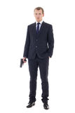 Full length portrait of man in business suit with gun isolated o Stock Photography