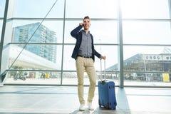 Full length portrait man calling at station Stock Image