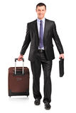 Full length portrait of a man carrying a suitcase Royalty Free Stock Photos