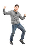 Full length portrait of a man gesturing happiness Stock Photo