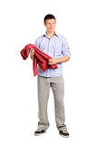 Full length portrait of a man holding a blouse Royalty Free Stock Photography