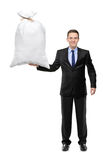 Full length portrait of a man holding a money bag Royalty Free Stock Image