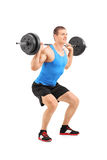 Full length portrait of man lifting heavy weight. Full length portrait of a man lifting a heavy weight isolated on white background Stock Photos