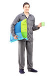 Full length portrait of a man in pajamas holding a pillow and a Royalty Free Stock Image