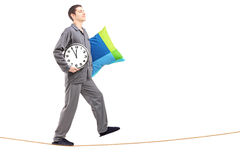 Full length portrait of a man with pillow and clock sleepwalking Royalty Free Stock Images