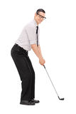 Full length portrait of a man playing golf Stock Image