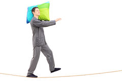 Full length portrait of a man sleepwalking on a rope Royalty Free Stock Photography