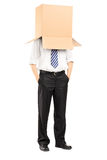 Full length portrait of a man standing with a cardboard box on h Stock Photo