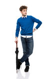 Full length portrait of a man standing with umbrella Royalty Free Stock Photography